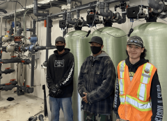 Industra - Kwadacha - Local workers next to water treatment plant system